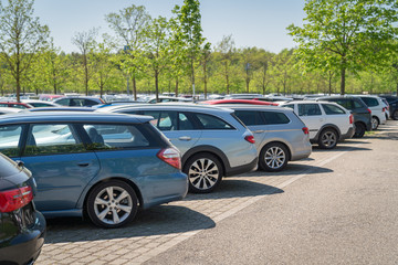 row of cars in parking lot