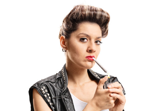 Punk girl lighting up a joint