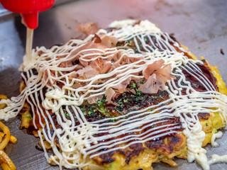 Okonomiyaki on hot pan