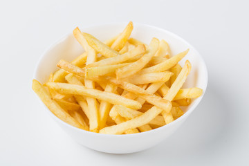 Fresh french fries served in bowl against white background