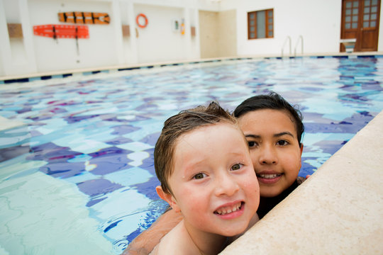 Smiling children in the swimming pool.