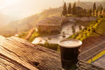Hot latte coffee in beautiful mountain view ,early morning, Khao Kho mountain,Phetchabun ,Thailand