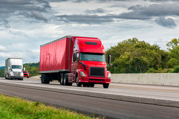 Red Semi Tractor-Trailer Travels The Interstate Highway