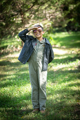 Boy in Maverick Pilot costume and aviator sunglasses