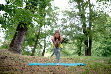 Young woman performing yoga outdoors