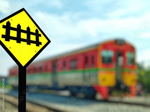 Focus on traffic warning guarded railway crossing sign and