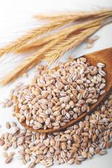 pearl barley in wooden spoon