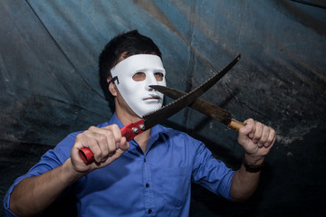 The man in white mask threatens, killer concept, horror theme , Halloween concepts