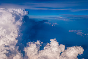 top view of the clouds and the blue sky from the plane window, the background of nature.
