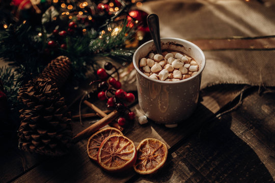 Christmas decorations near hot chocolate and spices