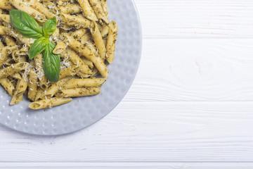 Italian penne pasta with sauce pesto