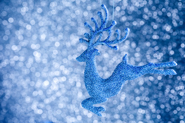Defocused Abstract Blurred Shiny Christmas blue Background with Sparkles Golden Ball   Decoration Happy New Year  Festive Holiday  with Light Effect Boke Space for text Selective focus