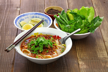 Lao khao soi, wide rice noodles soup with spicy minced pork, laos food