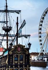 Old sailing ship and a modern Ferris wheel
