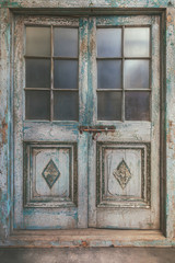 Ancient weathered double entrance door