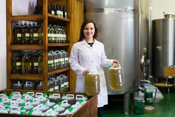 Woman near oil bottles