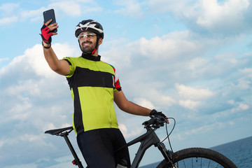 cyclist takes photo with his phone