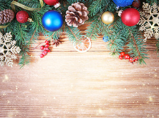 Christmas frame,fir decorations on wooden background.