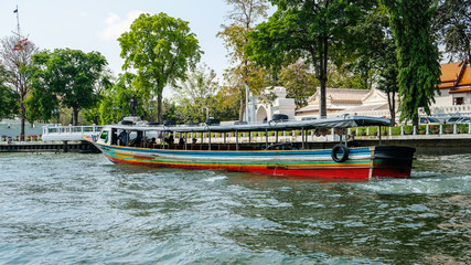 A Ferry Boat Leaving The Wat Arun Temple Terminal On The Chao Phraya River, Bangkok, Thailand