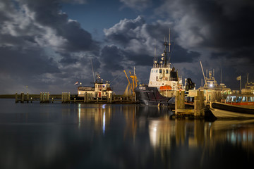 Ships in the harbor of West-Terschelling, an island in the wadden sea