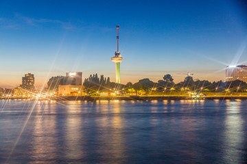 night view of the Euromast tower in Rotterdam in the Netherlands Holland with reflections of lights