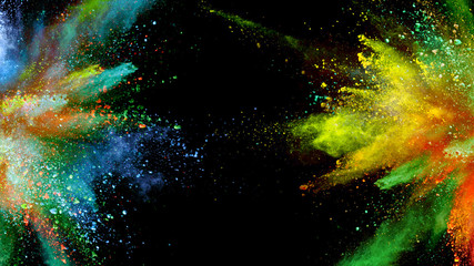 Multi-color powder explosion on black background