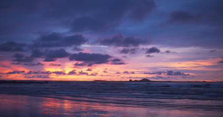 Background plate of pretty orange, purple and blue sunset at the beach