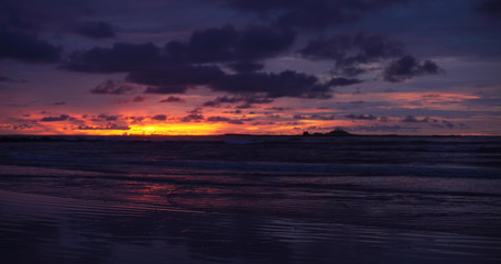 Gorgeous out of focus background plate of orange, purple and blue ocean sunset