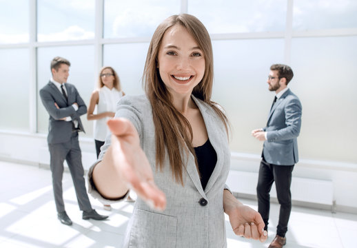 young business woman holding out her hand for a handshake