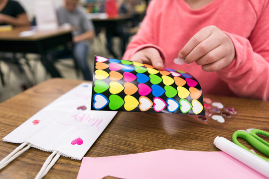 Classroom: Girl Decorates With Heart Stickers For Valentine's Day