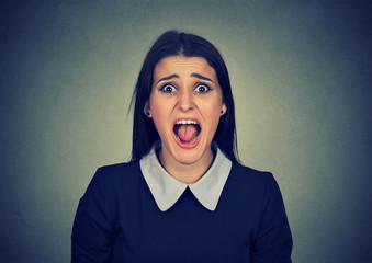 Angry woman screaming at camera