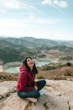 Portrait of woman sitting on the mountain