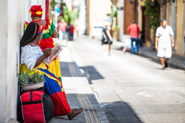 Zelfklevend Fotobehang Zuid-Amerika land Traditional fruits street vendor in Cartagena de Indias called Palenquera