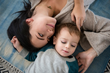 Mother and son relaxing on floor