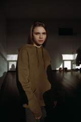 Portrait of woman in brown hood