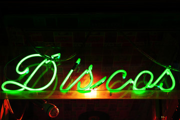 Neon shining sign on club entrance