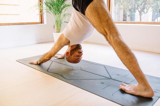 Crop yogi in handstand