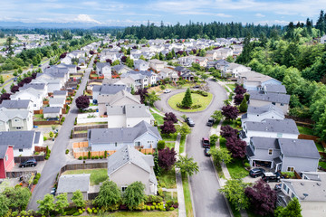 Aerial view of residential suburban houses with Mount Rainier in the background