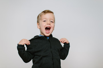 Silly young boy singing and dancing