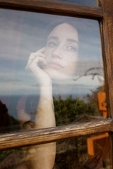 young woman behind window