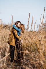 Beautiful young, wild couple in the countryside or seaside in Tu