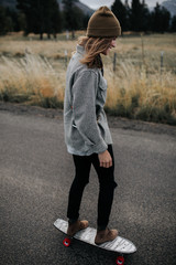 Girl skating on open road