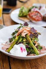 cafe breakfast, delicious warm salad with bacon, asparagus and p