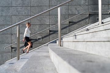 Businesswoman walking in a modern area