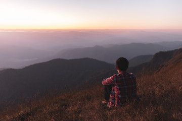 He watched the mountain view and sunset on the mountain alone. He is happy to be with herself and stay with nature.
