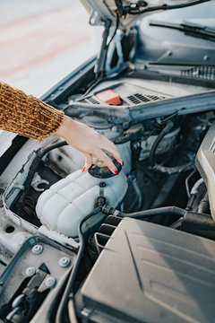 A woman with car problems