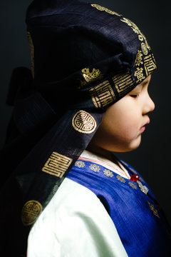 Child wearing ancestor's hanbok