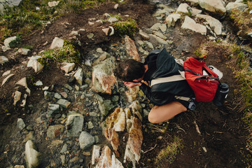 Drinking water from Glacial Creek on Backcountry Hike