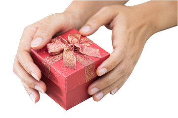 Hand holding red gift box.