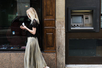 Stylish woman with wallet on street